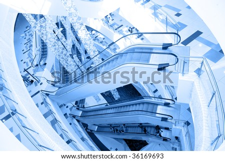 Escalator in modern building in blue - stock photo