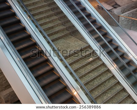 escalator in office. blurred motion. - stock photo