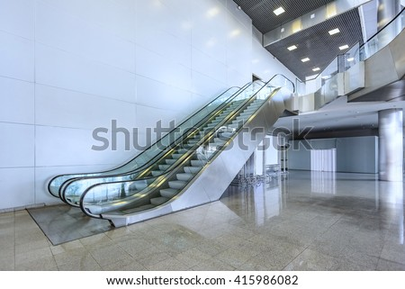 escalator in Pavilion shopping center in the room with glass - stock photo