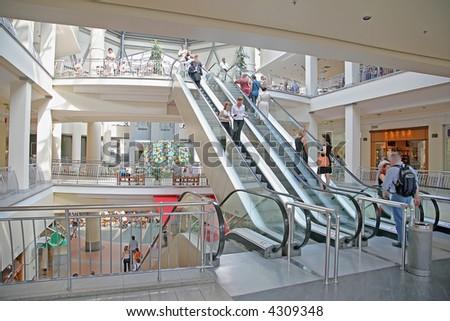 escalator in the mall - stock photo