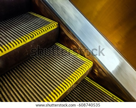 Moving Up Staircase. Escalator. Electric Escalator.Close Up To