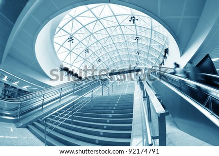 escalator ,interior of the airport . - stock photo