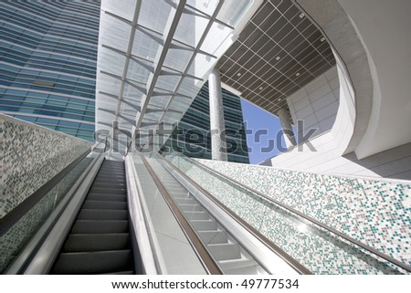 Escalator stairs at a modern office building center - going up, going down (Lisbon, Portugal) - stock photo