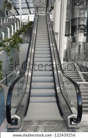 escalator stairway inside modern business center - stock photo
