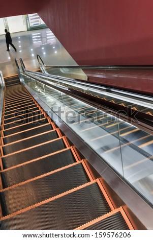 Escalator to underground shopping mall.  - stock photo