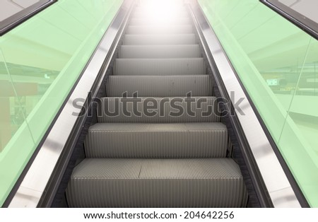 Escalator with green glass.  - stock photo
