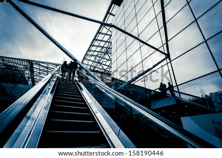 escalator with passengers motion blur - stock photo