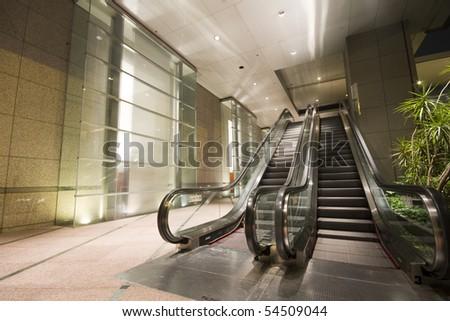 escalators in a building in hong kong at night - stock photo