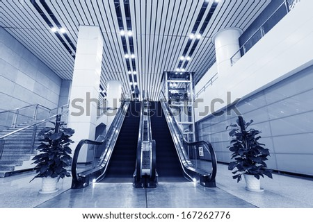 Escalators in an office building - stock photo