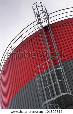 escape ladder on a oil storage tank - stock photo