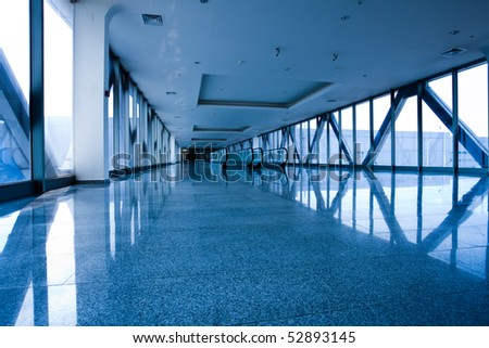 Escatator in blue hall and window in exposition center - stock photo