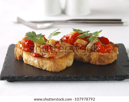 Esgarraet � Red pepper & cod Salad. �Esgarrat� or �esgarraet�,  is a typical Valencian dish served as starter or appetizer, and made with grilled red pepper, cured-salted cod, garlic, and olive oil. - stock photo