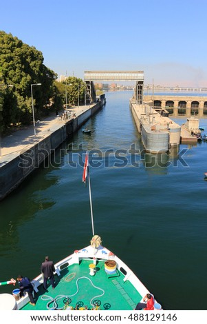ESNA, EGYPT - FEBRUARY 3, 2016: Approaching the Ship locks in Esna, and old dam on the Nile River, Egypt