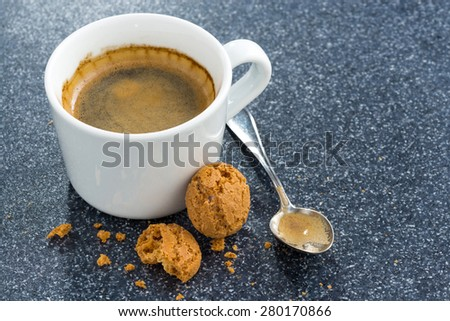 Espresso and almond biscuits on a dark background, top view, close-up - stock photo