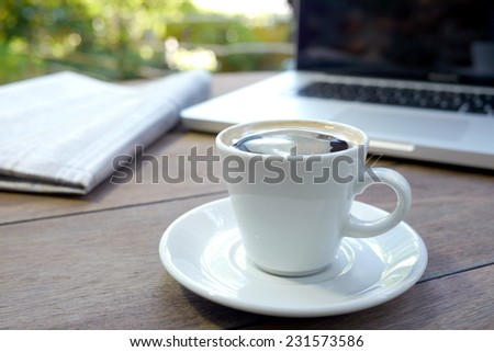espresso and computer on a cafe table