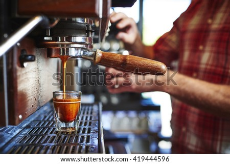 espresso being made at a coffee shop - stock photo