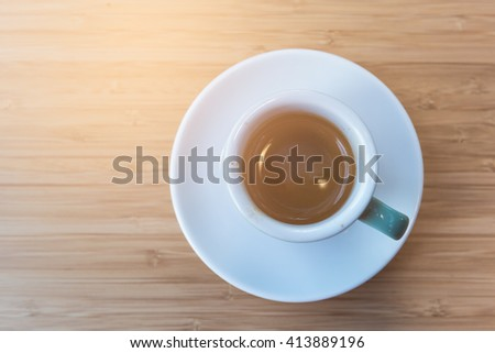 Espresso coffee cup. fresh morning coffee on the wooden table top views concept. - stock photo