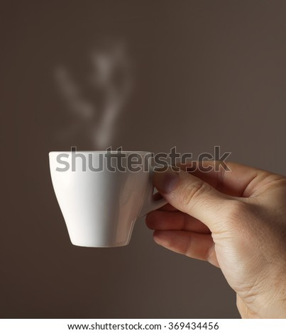 Espresso coffee cup isolated on brown background - stock photo