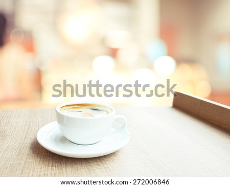 Espresso Coffee cup on wood table in cafe with bokeh light background, Leisure lifestyle concept - stock photo