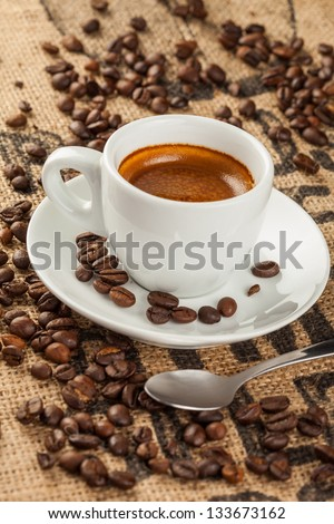 Espresso, coffee cup, spilled coffee beans