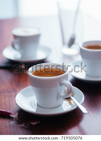 Espresso coffee cups on table