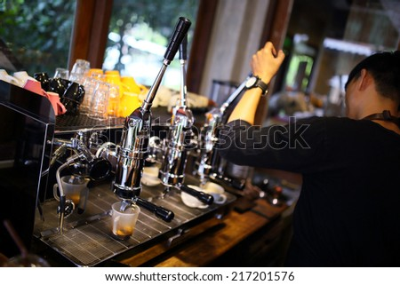 Espresso coffee machine with barista working - stock photo