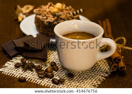 Espresso coffee on a wooden table, coffee beans, chocolate, cinnamon, warm white Ballance