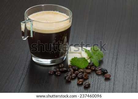 Espresso cup with beans and sugar - stock photo
