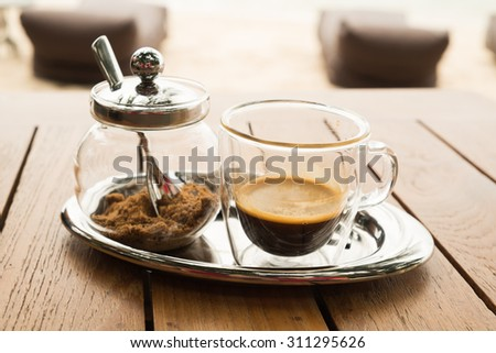 espresso cup with brown sugar  - stock photo