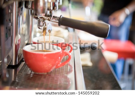 espresso, extraction from coffee machine - stock photo