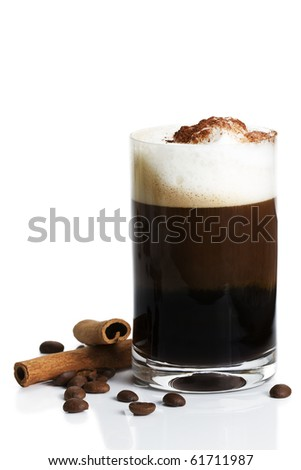 espresso in a straigt glass with milk froth cocoa powder, cinnamon sticks and coffee beans aside on white background - stock photo