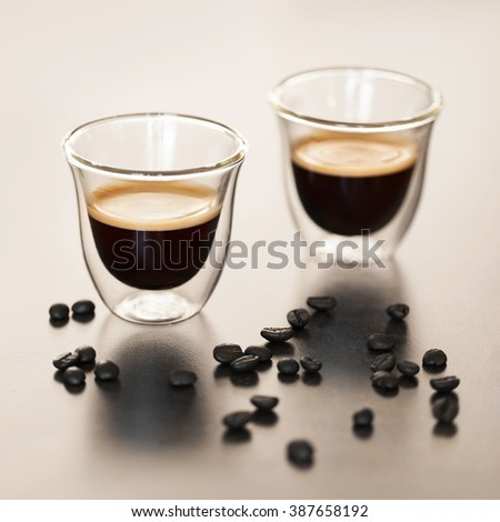 Espresso in a transparent cup - stock photo