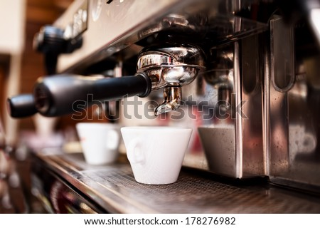Espresso machine making coffee in pub, bar, restaurant - stock photo