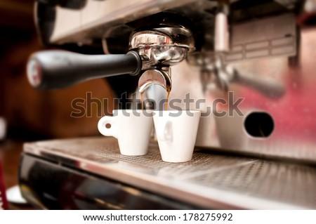espresso machine pouring coffee in cups - stock photo