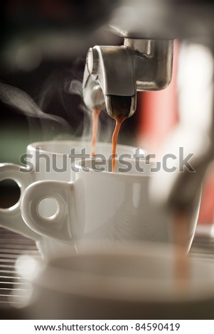 Espresso machine pouring two coffees