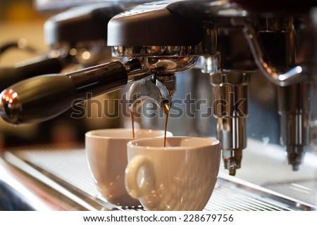 Espresso machine working with bar interior background - stock photo