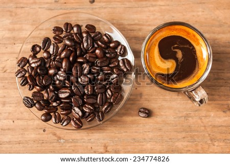 espresso shot coffee with notebook on wooden table. - stock photo