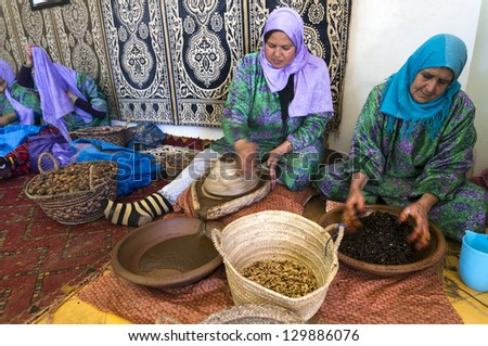 ESSAOUIRA, MOROCCO-FEBRUARY, 7: women working in a cooperative for the manufacturing of argan fruits in Essaouira, Morocco, February 24, 2013. Only women work in these cooperatives - stock photo