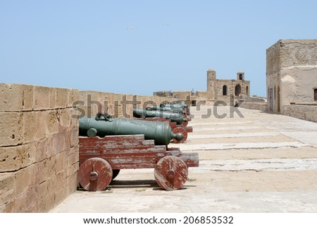 ESSAOUIRA, MOROCCO - MAY 14, 2014: Tourists exploring local historical landmark, a fortress close to the ocean. Essaouira, Morocco. May 14, 2014. - stock photo