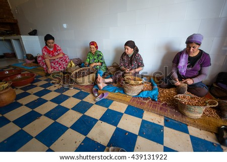 ESSAOUIRA, MOROCCO   NOVEMBER, 5: women working in a cooperative for the manufacturing of argan fruits in Essaouira, Morocco, November 5, 2013. Only women work in these cooperatives - stock photo