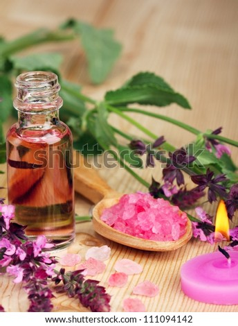 essential oil on a wooden background - stock photo