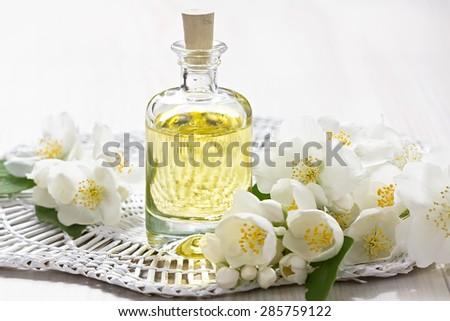 Essential oil with jasmine flower   - stock photo