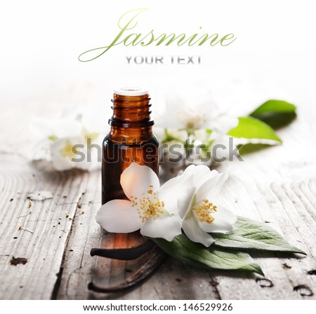 Essential oil with jasmine flower and vanilla - stock photo