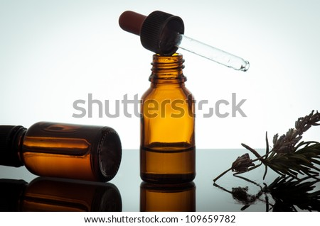 essential oil with lavender flowers and rosemary - stock photo