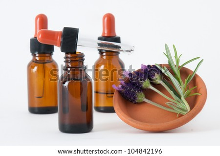essential oils and lavender flowers with rosemary - stock photo