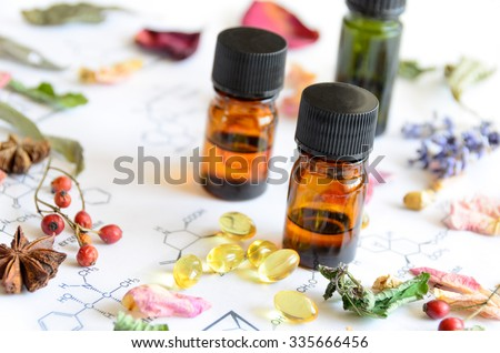essential oils and supplement on science sheet  - stock photo