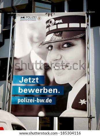 ESSLINGEN, GERMANY - APRIL 02,2014: Poster calling to join the German police. 20,000 women serve the German Police - stock photo