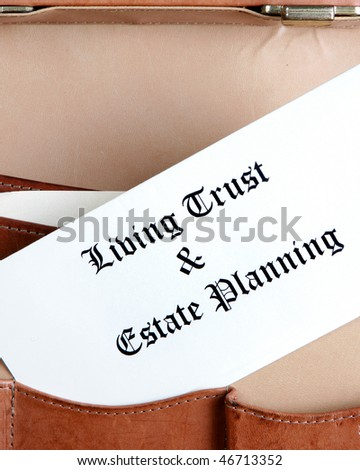 Estate planning documents in a leather briefcase - vertical - stock photo