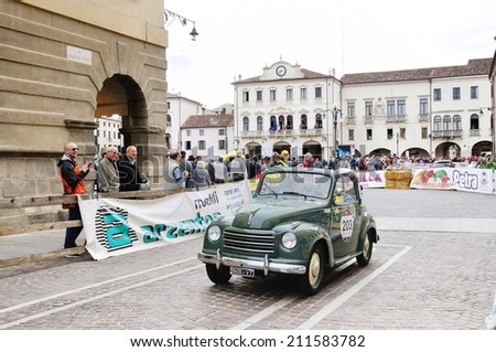ESTE (PD), ITALY - MAY 16: A green Fiat 500C Topolino takes part to the 1000 Miglia classic car race on May 16, 2014 in Este. The car was built in 1951 - stock photo