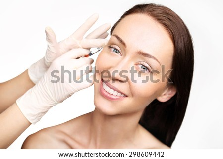 Esthetic surgery fill wrinkles.Portrait of a white woman during surgery filling facial wrinkles, Cosmetic is injected into facial skin cosmetics - stock photo